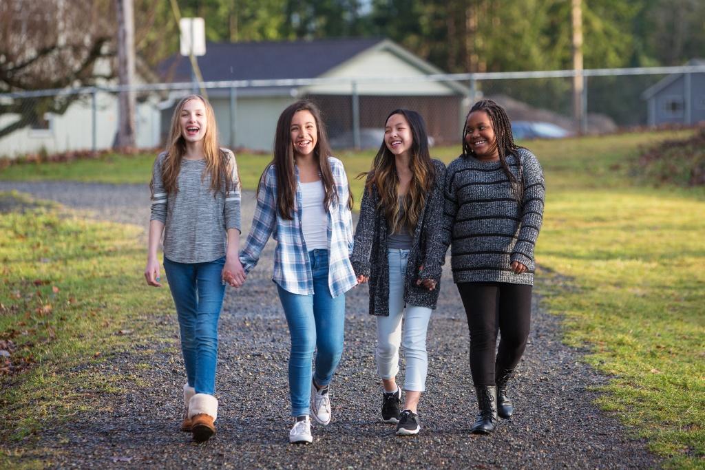 Teen girls walking outside